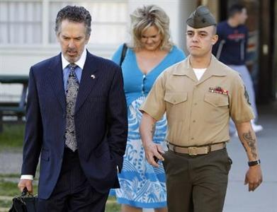 Marine Corps Staff Sgt. Frank D. Wuterich (R) arrives for a pre-trial hearing with his lawyer Neal A. Puckett and girlfriend Melissa Balcombe at Camp Pendleton, California in this file photo taken March 22, 2010. Wuterich, accused of leading a 2005 massacre of civilians in Haditha, Iraq, pleaded guilty on January 23, 2012 to one count of dereliction of duty, halting court-martial proceedings on manslaughter and other charges.  REUTERS/Mike Blake/Files