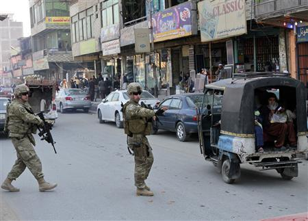 U.S. soldiers patrol in the eastern city of Jalalabad January 19, 2012.  REUTERS/Omar Sobhani