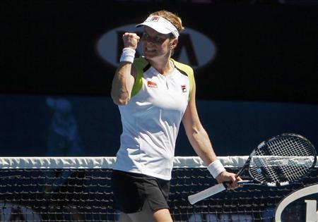 Kim Clijsters of Belgium celebrates during her women's singles quarter-finals match against Caroline Wozniacki of Denmark at the Australian Open tennis tournament in Melbourne January 24, 2012. REUTERS/Vivek Prakash