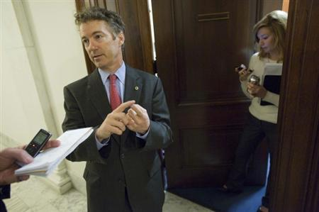 U.S. Senator Rand Paul (R-KY) (C) talks to a reporter outside of his office on Capitol Hill in Washington, January 23, 2012. REUTERS/Jonathan Ernst