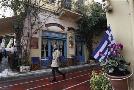 A man walks in front of a cafe at Plaka tourist district in Athens January 24, 2012.   REUTERS/John Kolesidis