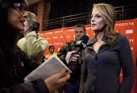 Cast member Helen Hunt talks to the media before the screening of the film ''The Surrogate'' during the Sundance Film Festival in Park City, Utah January 23, 2012. REUTERS/Jim Urquhart