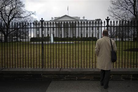 A man stands outside the North Lawn of the White House, January 24, 2012. REUTERS/Jonathan Ernst
