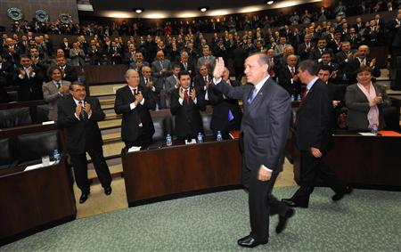 Turkey's Prime Minister Tayyip Erdogan (C) is greeted by members of parliament from his ruling AK Party (AKP) during a meeting at the Turkish parliament in Ankara January 24, 2012.  REUTERS/Stringer