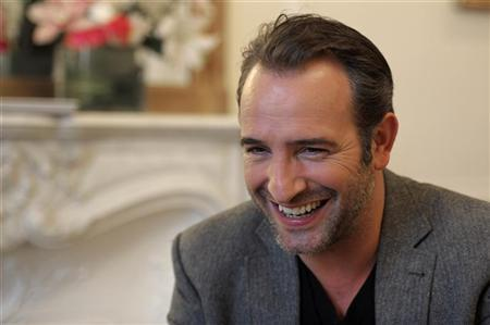 French actor Jean Dujardin speaks during an interview about the film ''The Artist'' in Paris January 24, 2012. REUTERS/Philippe Wojazer