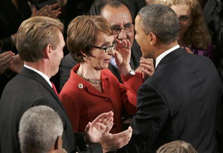 President Barack Obama (R) talks with Representative Gabrielle Giffords, shot in the head during a shooting spree in Tucson, Arizona last year as Rep. Jeff Flake (L) looks on before Obama's State of the Union address to a joint session of Congress on Capitol Hill in Washington, January 24, 2012.  REUTERS/Jonathan Ernst