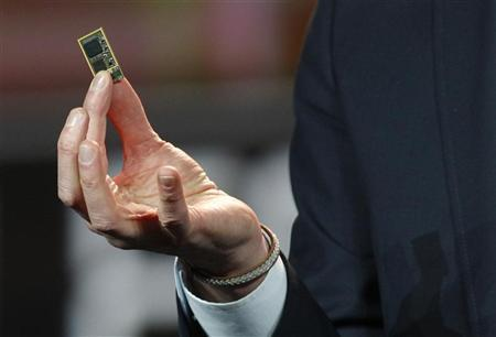 Hans Vestberg, president and chief executive of the Ericsson Group, holds a ST-Ericsson 4G LTE chip during his keynote address at the 2012 International Consumer Electronics Show (CES) in Las Vegas, Nevada, January 11, 2012.  REUTERS/Steve Marcus