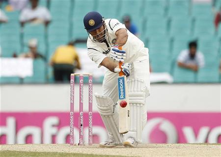 India's capatin Mahendra Singh Dhoni chips the ball up to be caught and bowled by Australia's Ben Hilfenhaus during the second cricket test, at the Sydney Cricket Ground January 6, 2012. REUTERS/Tim Wimborne
