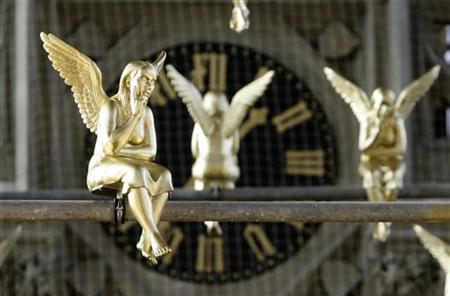 Golden angels attached at scaffolding are pictured during an exhibition in the Holy Cross church in Munich December 17, 2009. REUTERS/Michaela Rehle