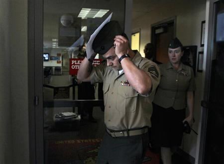 U.S. Marine Staff Sergeant Frank Wuterich leaves the courtroom after his sentencing at Camp Pendleton, January 24, 2012. REUTERS/Alex Gallardo