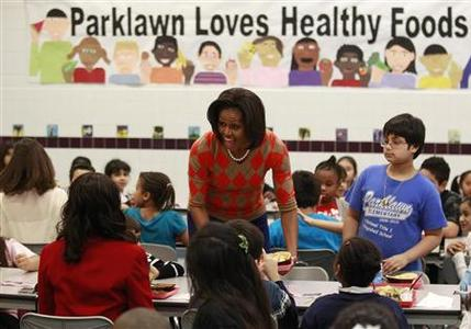 First Lady Michelle Obama has lunch with students at Parklawn Elementary School in Alexandria, Virginia January 25, 2012. REUTERS/Kevin Lamarque