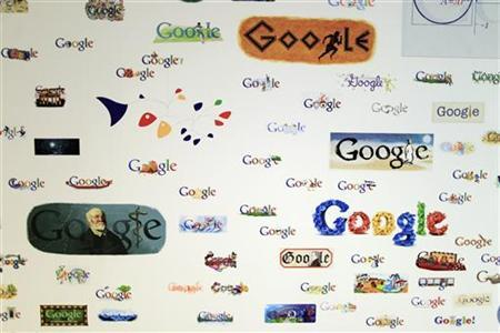 Google homepage logos are seen on a wall at the Google campus near Venice Beach, in Los Angeles, California January 13, 2012. REUTERS/Lucy Nicholson