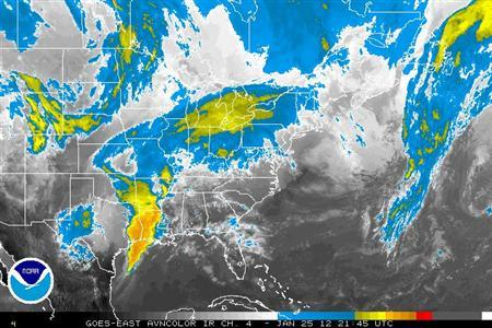 Storm systems are seen over the eastern and central United States in a satellite image taken Jan 25, 2012.  REUTERS/NOAA/Handout