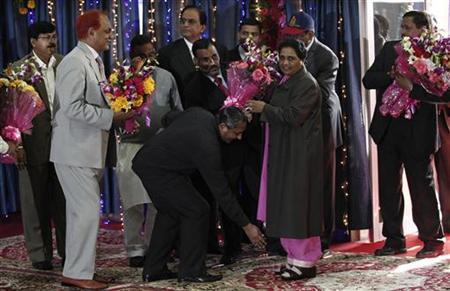 A member of Bahujan Samaj Party (BSP) takes blessings of Mayawati, the chief minister of Uttar Pradesh, upon her arrival for a news conference in Lucknow January 15, 2012.REUTERS/Adnan Abidi