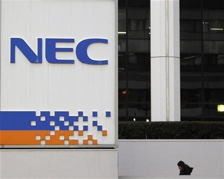 A woman walks near a signboard of NEC Corp in Tokyo January 26, 2012. REUTERS/Toru Hanai