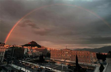A rainbow appears over the Greek parliament in Athens's Syntagma square January 25, 2012. REUTERS/Yannis Behrakis