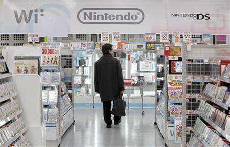 A man walks past Nintendo Co. Ltd.'s video game software titles at a Yamada Denki electronics retail store in Tokyo January 26, 2012.  REUTERS/Toru Hanai