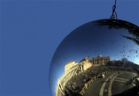 St. Peter Square is reflected in a Christmas decoration hanging from a Christmas tree in the Vatican December 26, 2011. REUTERS/Alessandro Bianchi/Files
