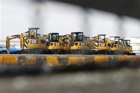 New excavators are seen at a port in Yokohama, south of Tokyo February 10, 2011.   REUTERS/Toru Hanai