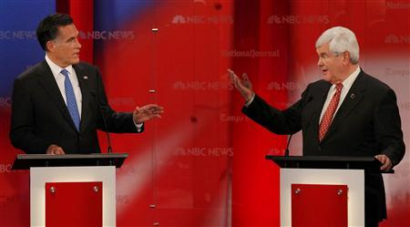 Republican presidential candidates (L-R) former Massachusetts Governor Mitt Romney and former Speaker of the House Newt Gingrich discuss a point during the Republican presidential candidates debate in Tampa, Florida, January 23, 2012.  REUTERS/Scott Audette