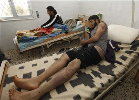 Ibrahim Mohammed from Assabia who says he was tortured at the hands of the Gharyan city forces during skirmishes between the two cities earlier this month lies in a hospital in Tripoli January 19, 2012.  REUTERS/Ismail Zitouny