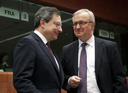 European Central Bank (ECB) President Mario Draghi (L) talks with EU Monetary Affairs Commissioner Olli Rehn (R) at a European Union finance ministers meeting at the European Union council headquarters in Brussels January 23, 2012.               REUTERS/Yves Herman