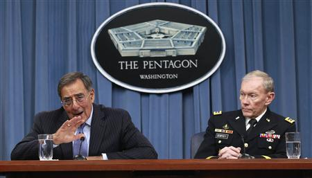 Defense Secretary Leon Panetta and Chairman of the Joint Chiefs of Staff General Martin Dempsey brief the media at the Pentagon Briefing Room, January 26, 2012.  REUTERS/Kevin Lamarque