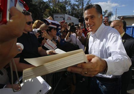 Republican presidential candidate and former Massachusetts Governor Mitt Romney signs autographs during a campaign stop at Paramount Printing in Jacksonville, Florida January 26, 2012. REUTERS/Brian Snyder