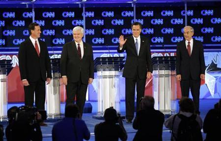 Republican presidential candidates (L-R) former U.S. Senator Rick Santorum (R-PA), former Speaker of the House Newt Gingrich, former Massachusetts Governor Mitt Romney and U.S Representative Ron Paul (R-TX) stand on stage before the Republican presidential candidates debate in Jacksonville, Florida January 26, 2012.  REUTERS/Scott Audette