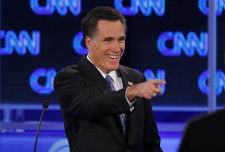 Republican presidential candidate former Massachusetts Governor Mitt Romney laughs during the Republican presidential candidates debate in Jacksonville, Florida, January 26, 2012. REUTERS/Scott Audette