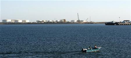 A speed boat passes by oil docks at the port of Kalantari in the city of Chabahar, 300km (186 miles)  east of the Strait of Hormuz January 17, 2012. REUTERS/Raheb Homavandi