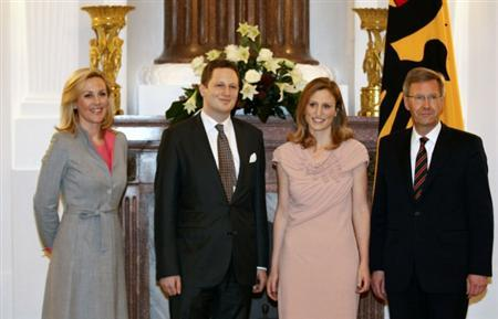 German President Christian Wulff (R) and his wife Bettina (L) pose with Prince Georg Friedrich and Princess Sophie of Prussia before a reception at the presidential Bellevue palace in Berlin January 16, 2012. REUTERS/Tobias Schwarz