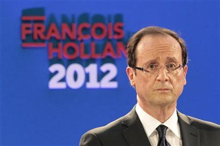 Francois Hollande, Socialist Party candidate for the 2012 French presidential election, delivers a speech in Paris January 26, 2012. REUTERS/Charles Platiau