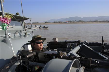 Thai marines patrol the Mekong river near Sop Ruak in the Golden Triangle region where the borders of Thailand, Laos and Myanmar meet January 18, 2012. REUTERS/Sinthana Kosolpradit
