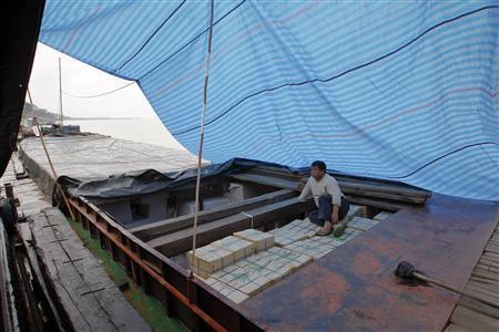 A worker pauses after loading a Chinese boat at the Thai Mekong river port of Chiang Saen in the Golden Triangle region where the borders of Thailand, Laos and Myanmar meet January 14, 2012.  REUTERS/Sukree Sukplang