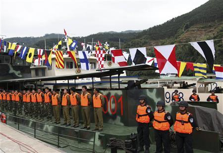 Chinese policemen stand in formation on a patrol boat as they prepare for their first patrol mission along the Mekong River, in Guanlei port, Xishuangbanna Dai Autonomous Prefecture, Yunnan province, December 10, 2011. REUTERS/China Daily/Files