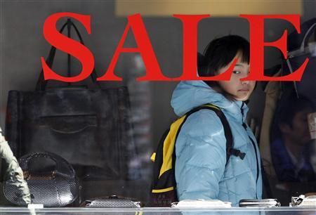 A woman looks at bags displayed inside a shop in Tokyo January 27, 2012.  REUTERS/Toru Hanai