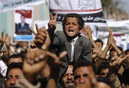 A boy shouts slogans with anti-government protesters as they march to demand the release of detained fellow protesters in Sanaa January 26, 2012. REUTERS/Khaled Abdullah