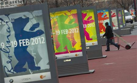 A man walks past posters advertising the upcoming Berlinale international film festival in Berlin, January 23, 2012. REUTERS/Thomas Peter