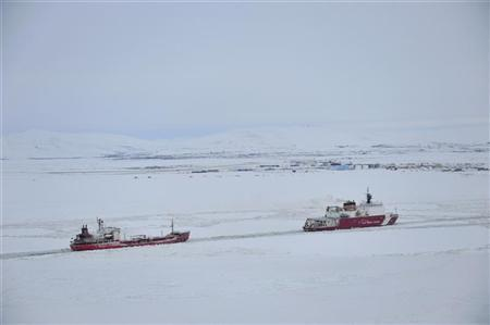 The U.S. Coast Guard cutter Healy guides the Russian tanker Renda closer to the fuel transfer mooring point off the coast of Nome, Alaska, January 14, 2012. REUTERS/Charly Hengen/U.S. Coast Guard/Handout