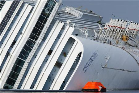 Firefighter rescuers work on the cruise liner Costa Concordia, which ran aground off the west coast of Italy at Giglio island January 26, 2012.  REUTERS/Darrin Zammit Lupi