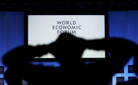 A participant watches a session at the World Economic Forum (WEF) in Davos, January 27, 2012.     REUTERS/Christian Hartmann