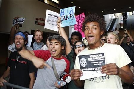 Protestors supporting International Bank Transfer Day demonstrate before the premiere of the new film ''A Very Harold & Kumar 3D Christmas'' in Hollywood November 2, 2011.  REUTERS/Fred Prouser