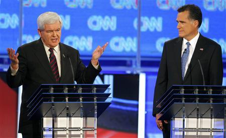 Newt Gingrich makes a point as Mitt Romney listens during the Republican presidential candidates debate in Jacksonville, Florida January 26, 2012. REUTERS/Scott Audette
