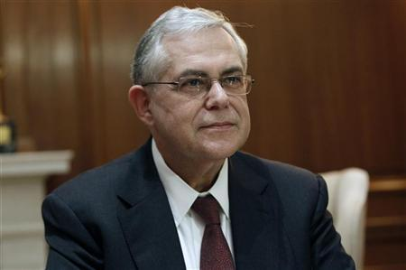 Greek Prime Minister Lucas Papademos is seen in his office during a meeting with Greek political leaders in Athens January 19, 2012.  REUTERS/Yiorgos Karahalis