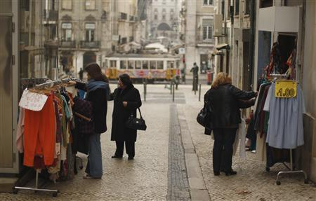 A shop sells garments for one euro in downtown Lisbon January 26, 2012.  REUTERS/Rafael Marchante