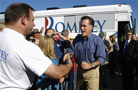 Republican presidential candidate and former Massachusetts Governor Mitt Romney arrives for a campaign rally at Eastern Shipbuilding Group in Panama City, Florida January 28, 2012.REUTERS/Brian Snyder