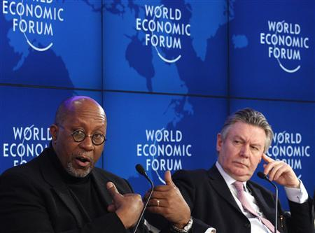 EU Trade Commission Karel De Gucht (R) and U.S. Trade Representative Ron Kirk attend a session at the World Economic Forum (WEF) in Davos, January 28, 2012. REUTERS/Christian Hartmann