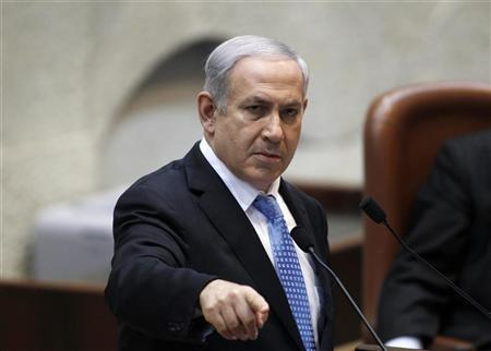 Israel's Prime Minister Benjamin Netanyahu gestures as he speaks during a special session marking the International Holocaust Remembrance Day in the Knesset, the Israeli parliament, in Jerusalem January 24, 2012. REUTERS/Baz Ratner