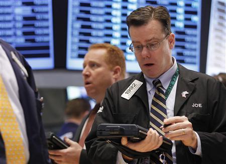 Traders work on the floor of the New York Stock Exchange January 27, 2012. REUTERS/Brendan McDermid